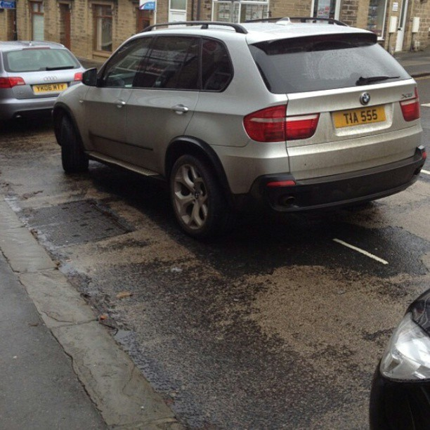Now at 3 silver X5s. Tia 555 catching a bus to the curb. #selfishparker