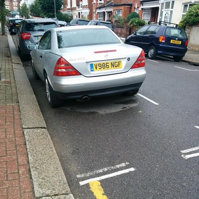 V986 NGF displaying Inconsiderate Parking