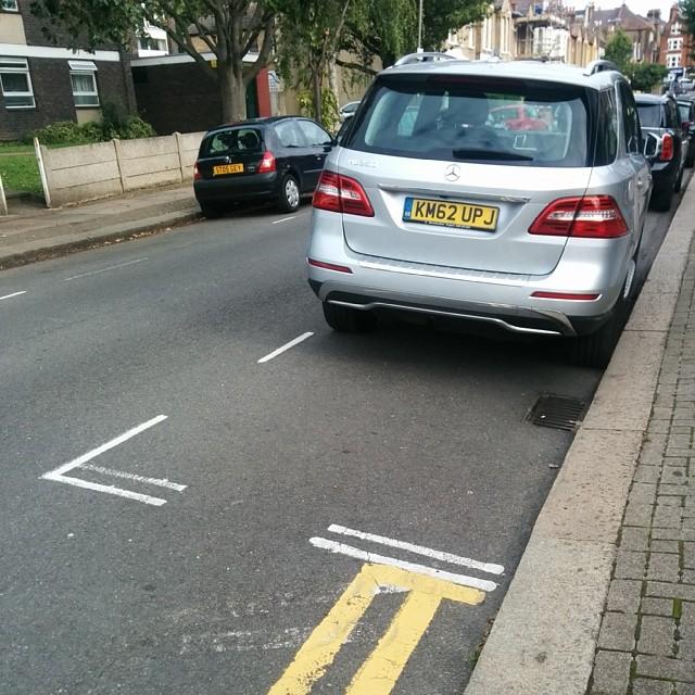 KM62 UPJ displaying Inconsiderate Parking