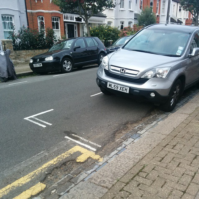 ML59 XEH displaying Inconsiderate Parking