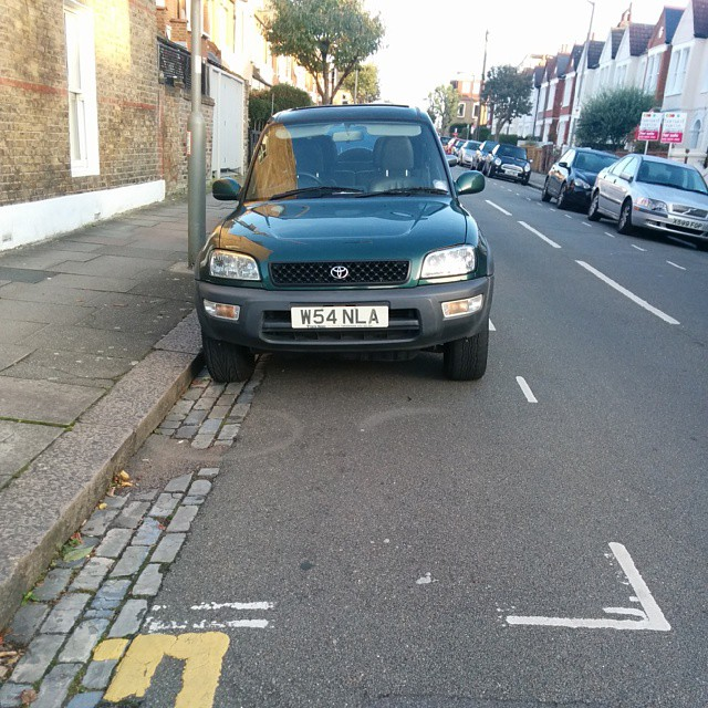 W54 NLA not considering others on a busy residential rd by using the lines properly. #selfishparker AGAIN!