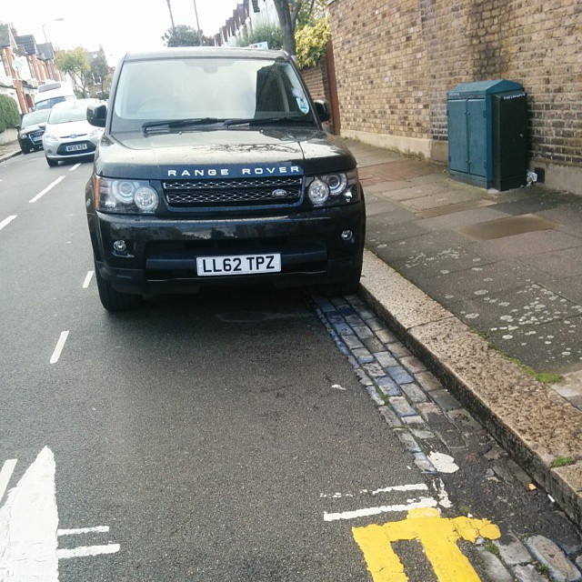 LL62 TPZ not considering others on a busy residential rd by using the lines properly. #selfishparker AGAIN!
