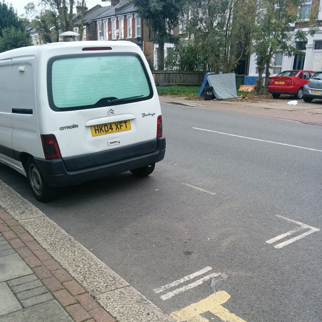 HK04 XFT not considering others on a busy residential rd by using the lines properly. #selfishparker